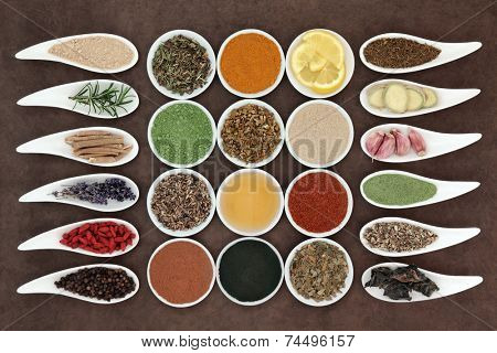 Immune boosting health food selection in porcelain dishes over lokta paper background.