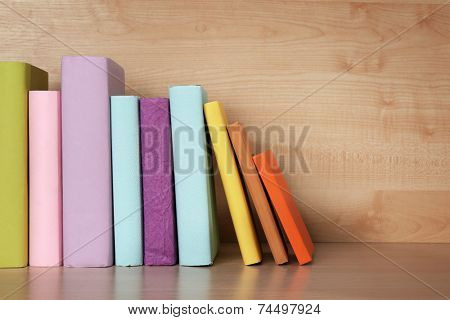 Books on wooden shelf close-up