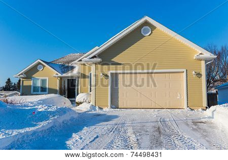 A typical suburban home in north america during the winter.