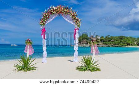wedding arch, cabana, gazebo on tropical beach decorated with flowers, beach wedding decoration