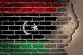 stock photo of libya  - Dark brick wall texture with plaster  - JPG