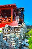 picture of water-mill  - Old syle house with water mill on the blue sky background - JPG