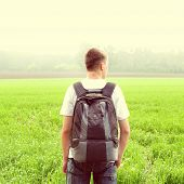 image of knapsack  - Toned photo of Teenager with Knapsack at the Summer Field - JPG