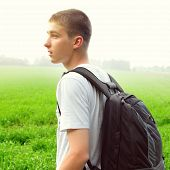 picture of knapsack  - Toned photo of Teenager with Knapsack at the Summer Field - JPG