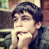 picture of pity  - Toned photo of sad Teenager Portrait outdoor