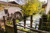 stock photo of water-mill  - The shovels of an old water mill now in disuse - JPG