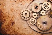 foto of mechanical engineering  - Steampunk background from mechanical clocks details over old metal background - JPG