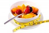 Bowl Of Fresh Fruit Salad With Tape Measure