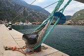 picture of bollard  - mooring bollard with knotted nautical ropes closeup - JPG
