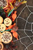 pic of spiderwebs  - Different sweets for Halloween party on dark background with spiderweb - JPG
