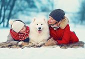 pic of christmas dog  - Beautiful happy family mother and son walking with white Samoyed dog in park on a winter day - JPG