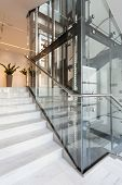 stock photo of elevators  - View of glass elevator in modern building - JPG