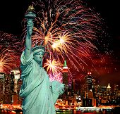 stock photo of new york skyline  - The Statue of Liberty and holiday fireworks - JPG
