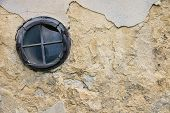 foto of uglich  - Old circle destroyed window in cracked wall - JPG