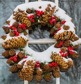 image of cone  - Christmas cone wreath covered in snow - JPG