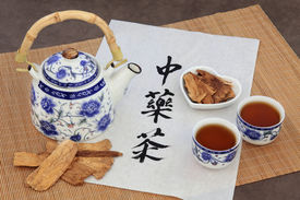 stock photo of chinese calligraphy  - Astragalus herb tea also used in chinese herbal medicine - JPG
