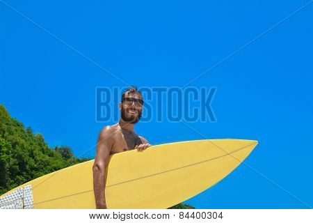 Male surfer waiting for the wave