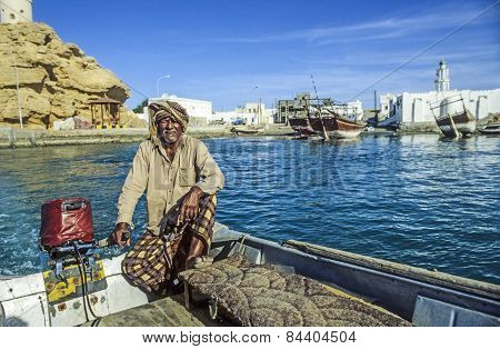 Arabic Ferry Man Transports Passenger In An Old Traditional Boat
