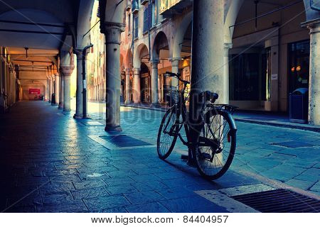 Cyclists At The Column In The Arcade In Mantova