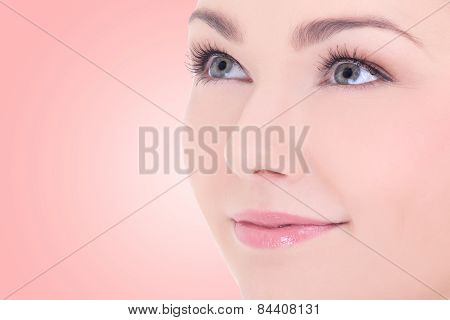 Close Up Portrait Of Young Beautiful Woman With Long Eyelashes Over Beige
