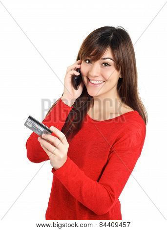 Girl Looking With Credit Card On Mobile Phone