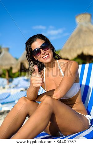 Positive Woman On Vacation At Tropical Resort Beach