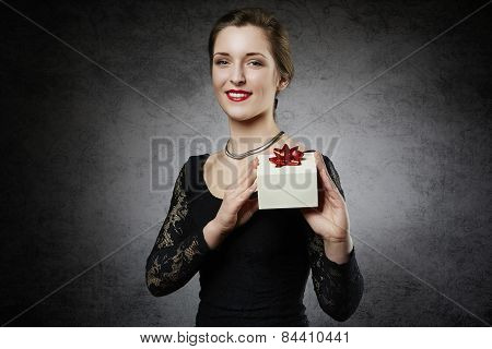 Attractive cheerful woman with gift box
