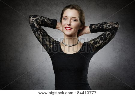 Cheerful young woman in black dress