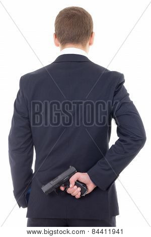 Man In Business Suit Hiding Gun Behind His Back Isolated On White
