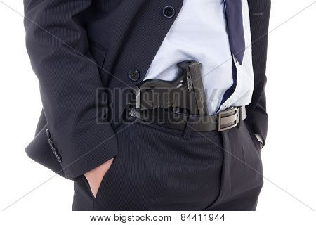 Close Up Of Gun In Policeman Or Bodyguard Pants Isolated On White
