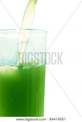 Green Juice Pouring In Glass On White Background.