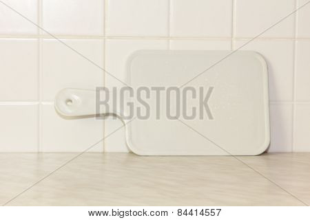White Plastic Cutting Board With Empty Space For Your Menu Text.