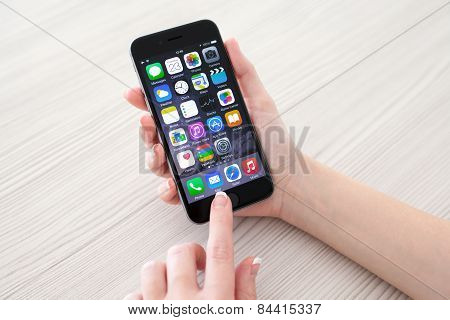 Woman Holding Phone Iphone 6 Space Gray Over The Table