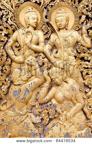 Religious carvings on the doors of Wat Xieng Thong