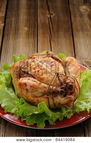 Bondage Shibari Roasted Chicken With Salad Leaves On Red Plate On Wooden Background With Space