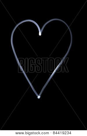 Illuminated Heart With Light On A Black Background