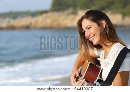 Beautiful Guitarist Woman Playing Guitar On The Beach
