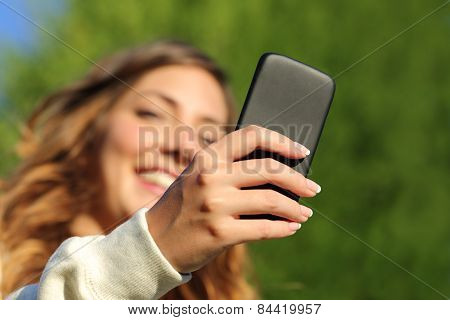 Bottom View Of A Woman Hand Texting On A Smart Phone