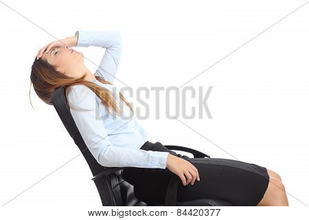 Profile Of A Tired Businesswoman Sitting On A Chair