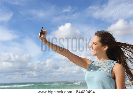 Girl Photographing A Selfie With A Smart Phone On The Beach