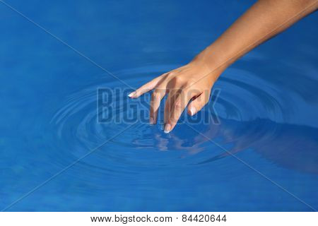 Woman Hand With Perfect Manicure Playing With Water In A Pool