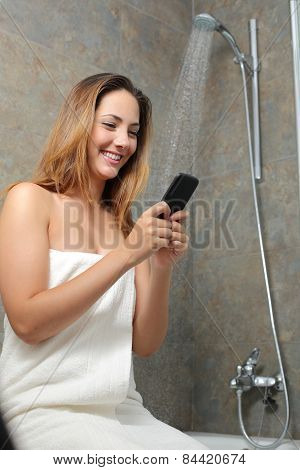 Woman On The Phone In The Shower While Is Wasting Water