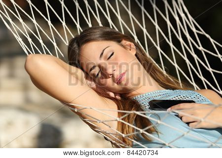 Woman Sleeping And Resting On A Hammock