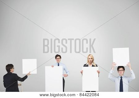 Businesspeople Holding Blank Placard