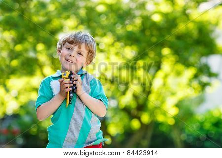 Little Kid Boy Playing With Car Toy, Outdoors