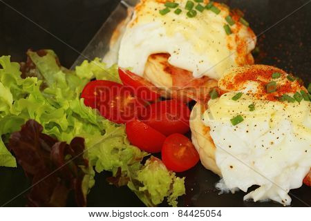Eggs Benedict ,vegetable ,eggs On A Black Plate.