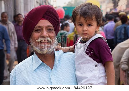 Delhi, India - November 5: Unidentified Man With Unidentified Child Walks At Chandni Chowk On Novemb