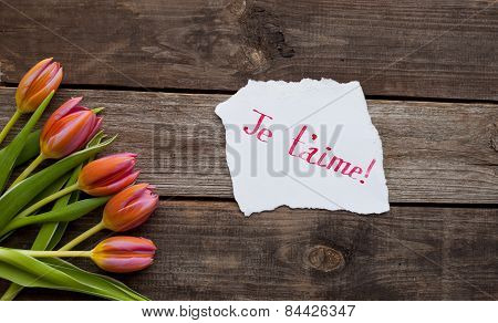 Five Bright Tulips On A Wooden Table
