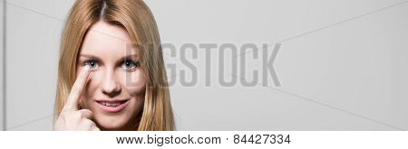 Attractive Woman Using Contact Lenses