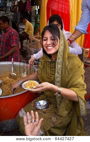 Delhi, India - November 5: Unidentified Woman Gives Away Rice During Guru Nanak Gurpurab Celebration